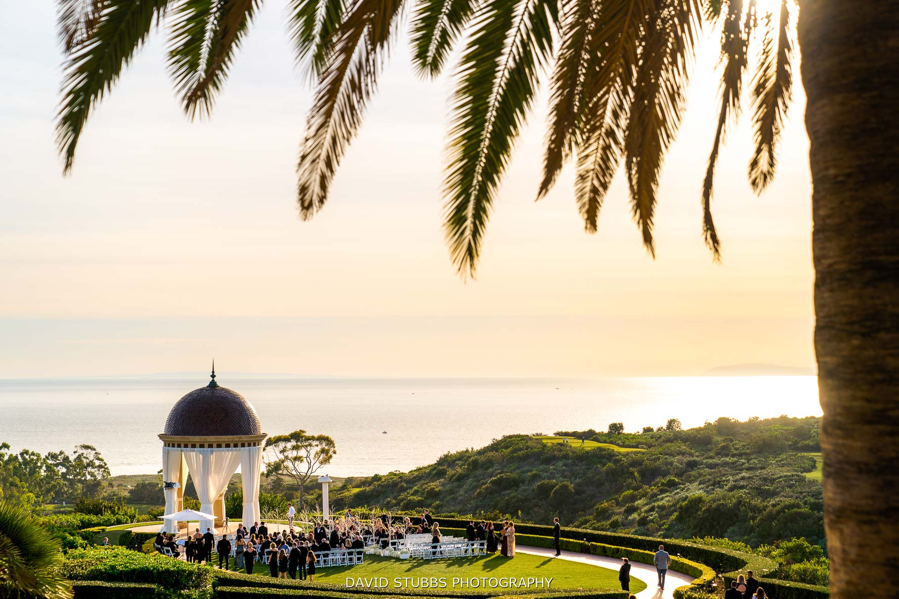 sunset wedding ceremony at pelican hill resort