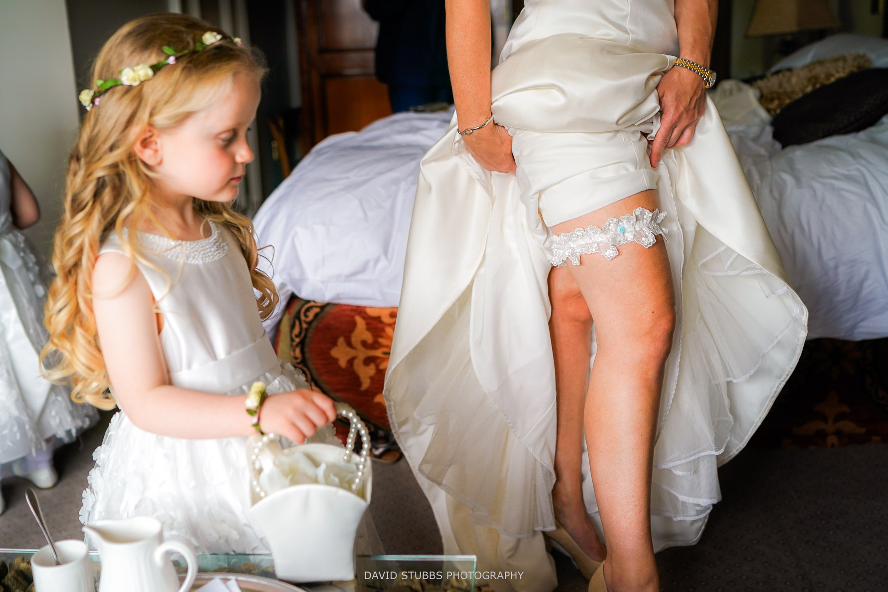 putting the garter on her leg