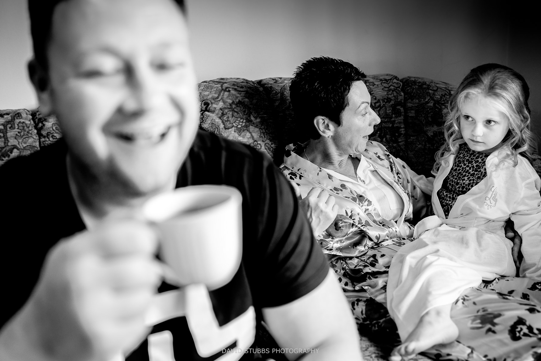 family together drinking tea