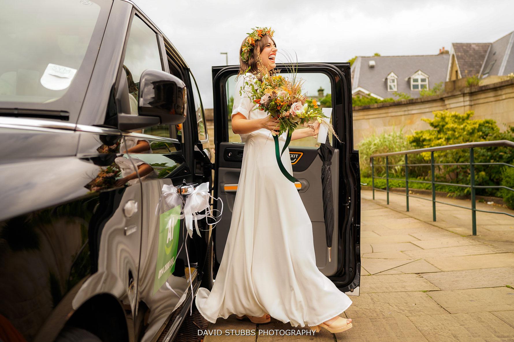 bride leaving the wedding car