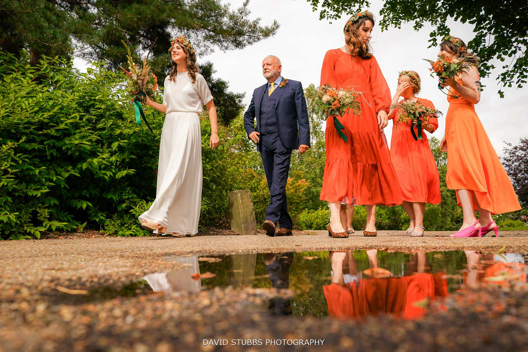 wedding reflection in puddle