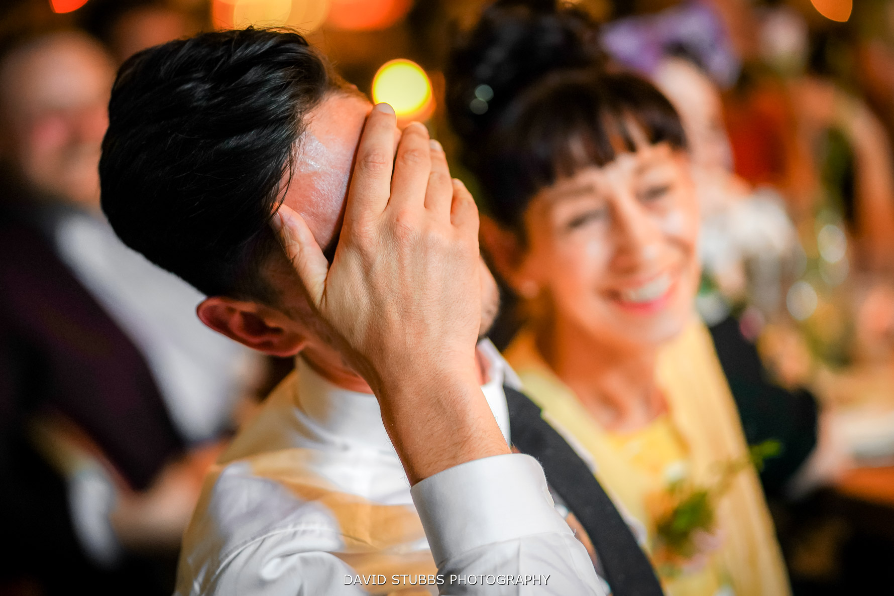 groom with hand over his face