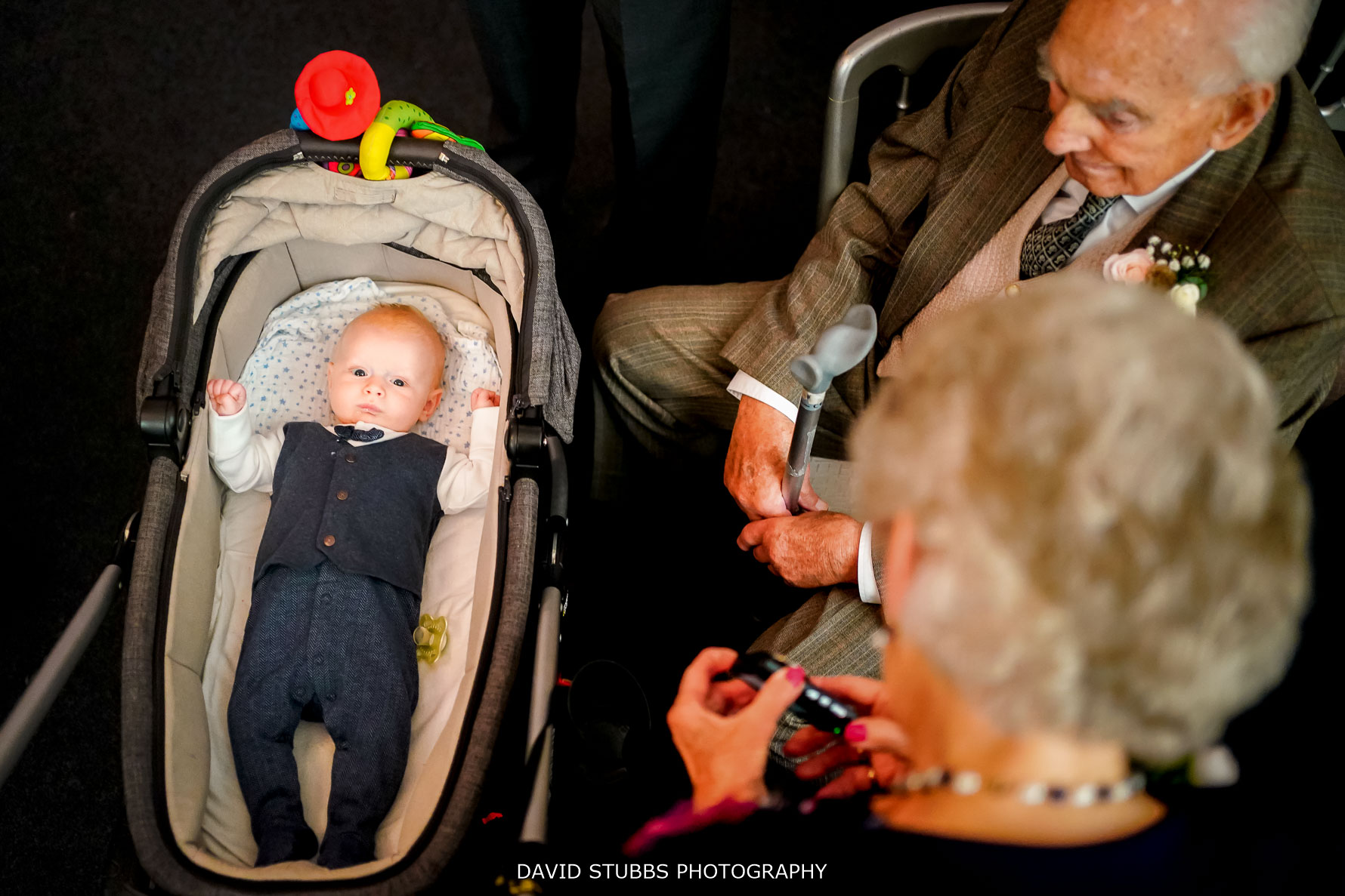 baby in pram with grandparents