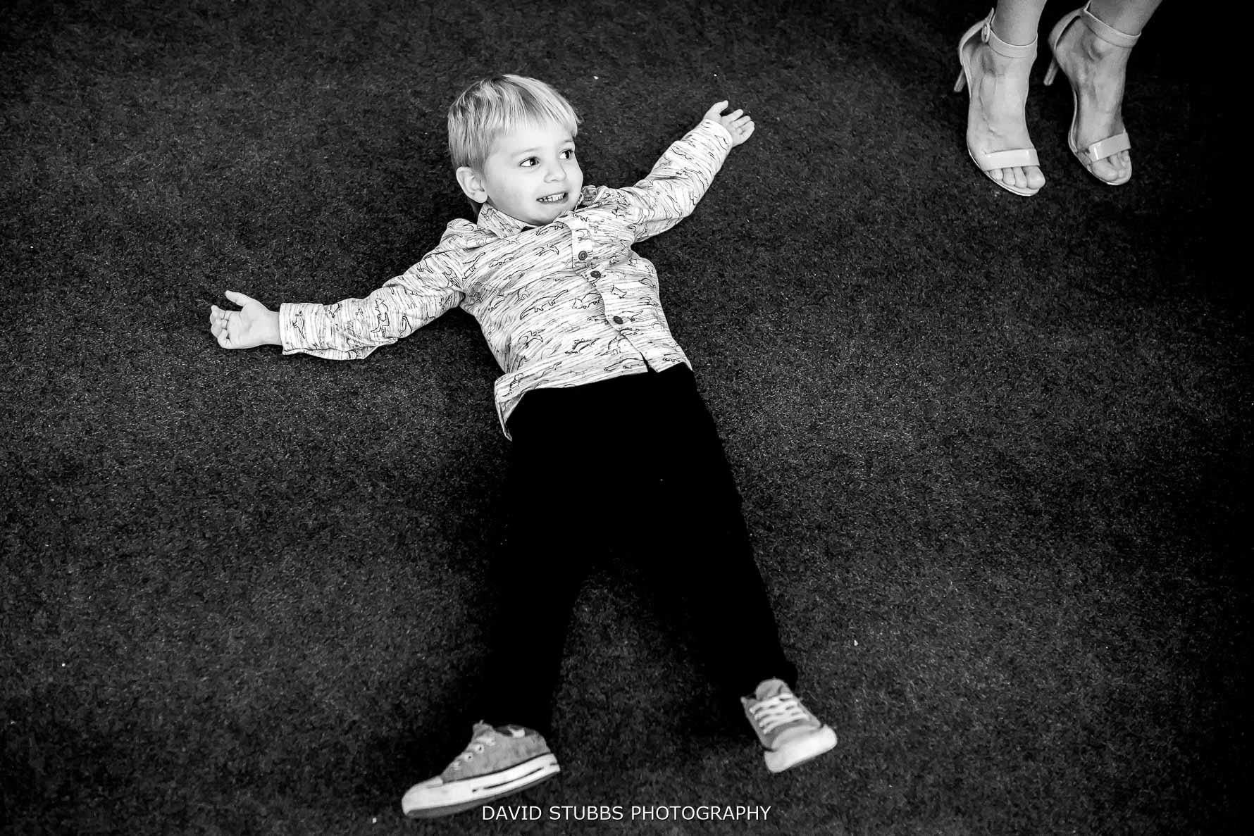 kid laying on barn floor
