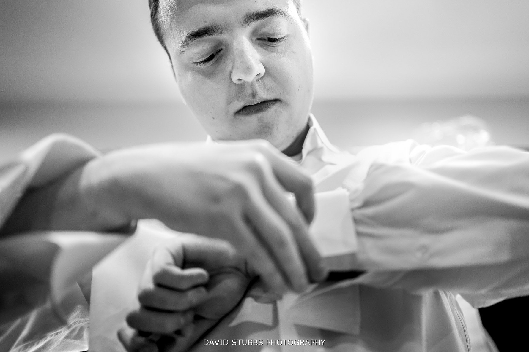 will the groom doing up his cufflinks