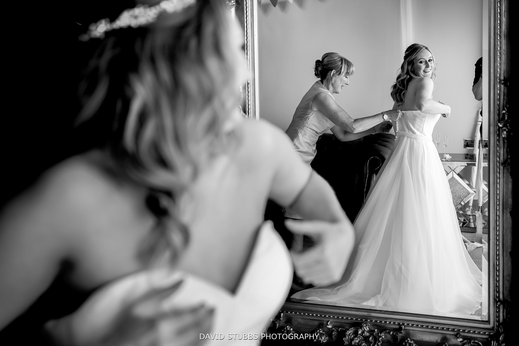 bride in mirror reflection during preparations