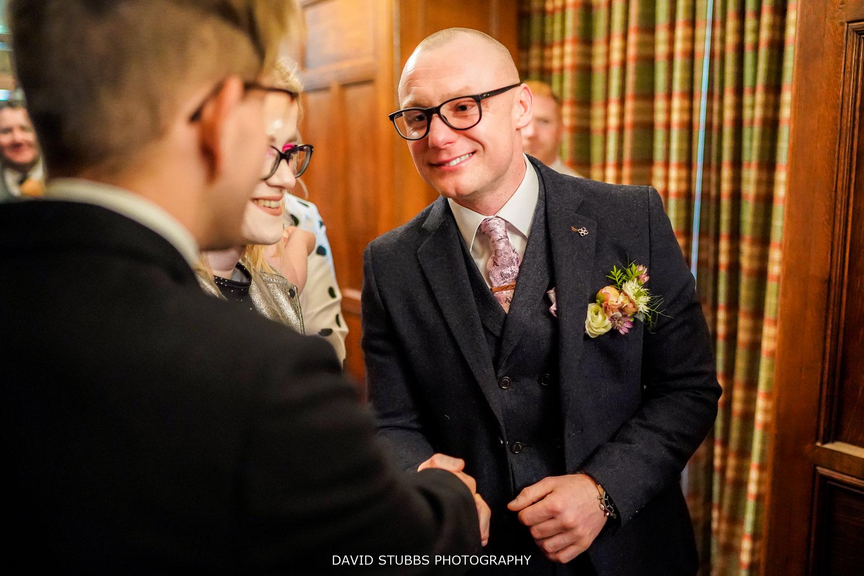close up photo of wedding groom