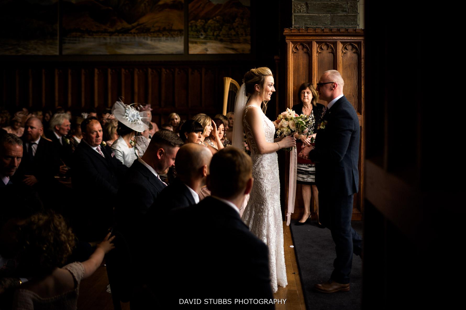 wedding ceremony in stone room at lingholm estate