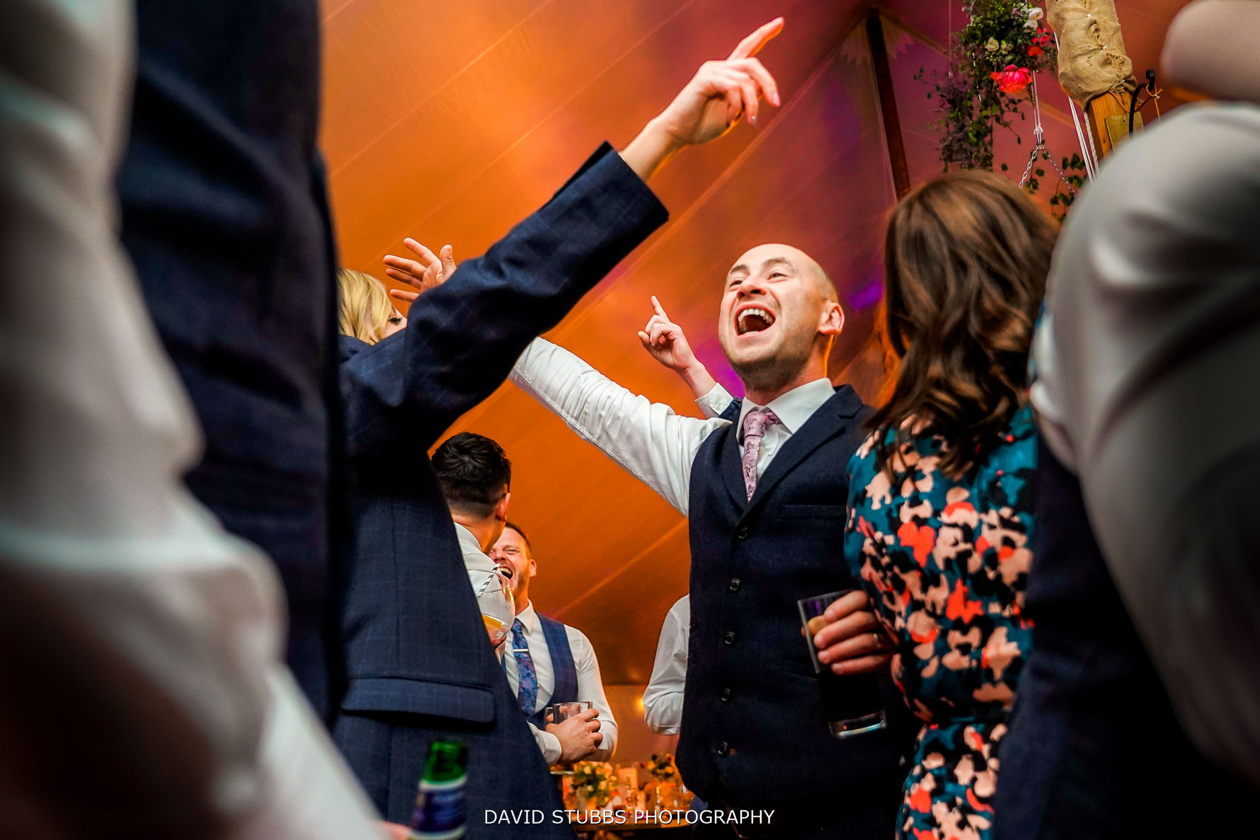 wedding photography with arms in air