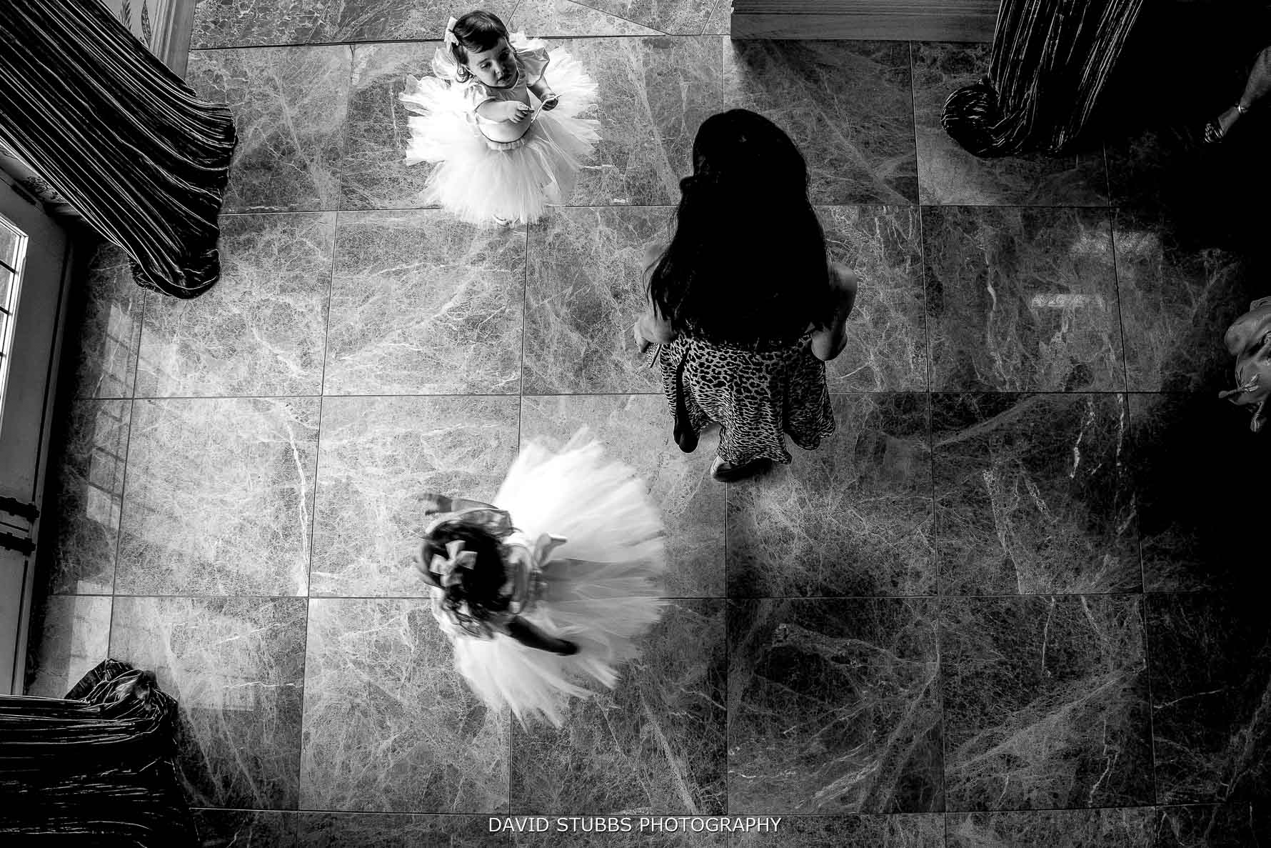 taken from above of the flower girls spinning