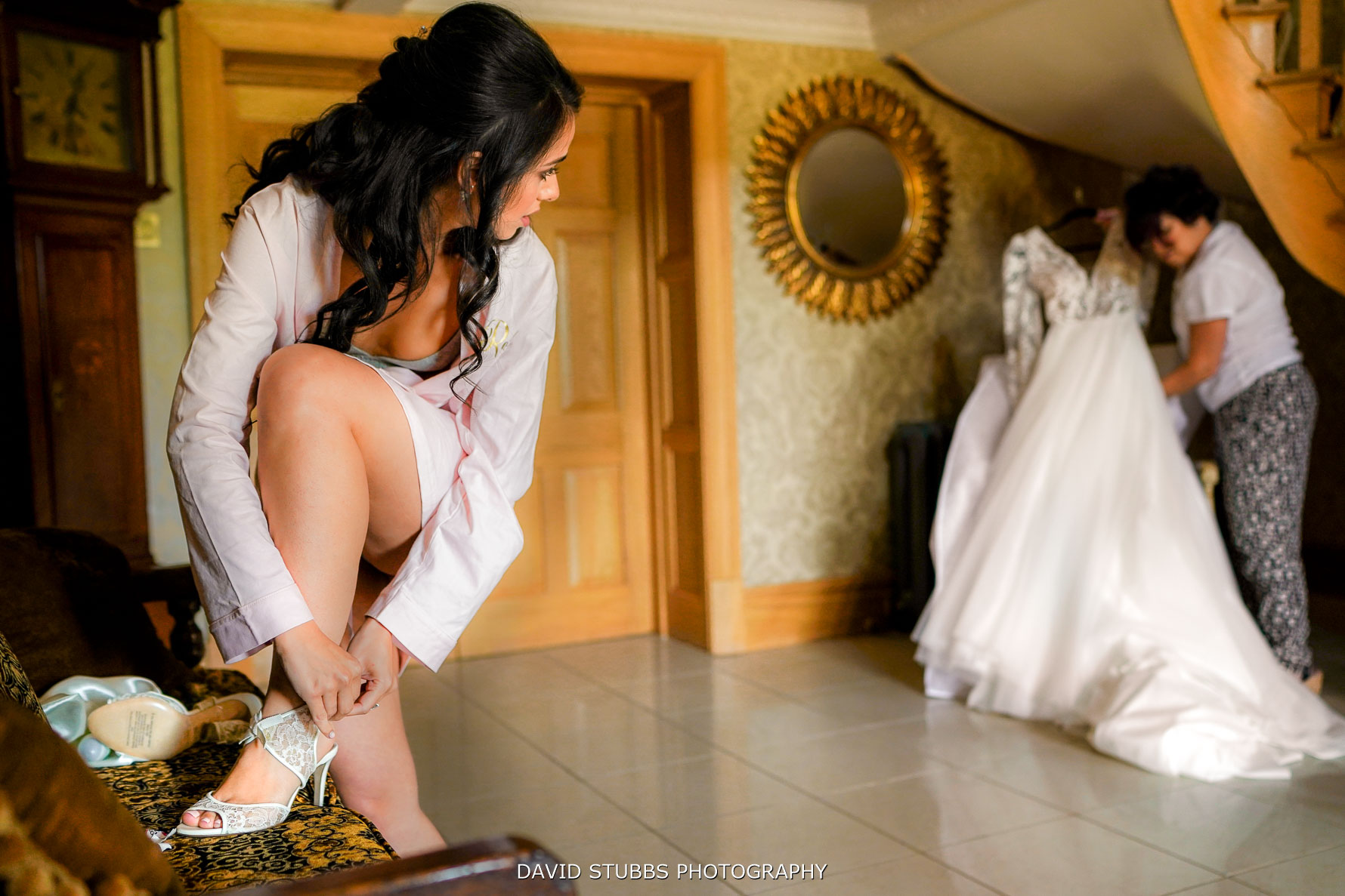 wedding shoes being put on