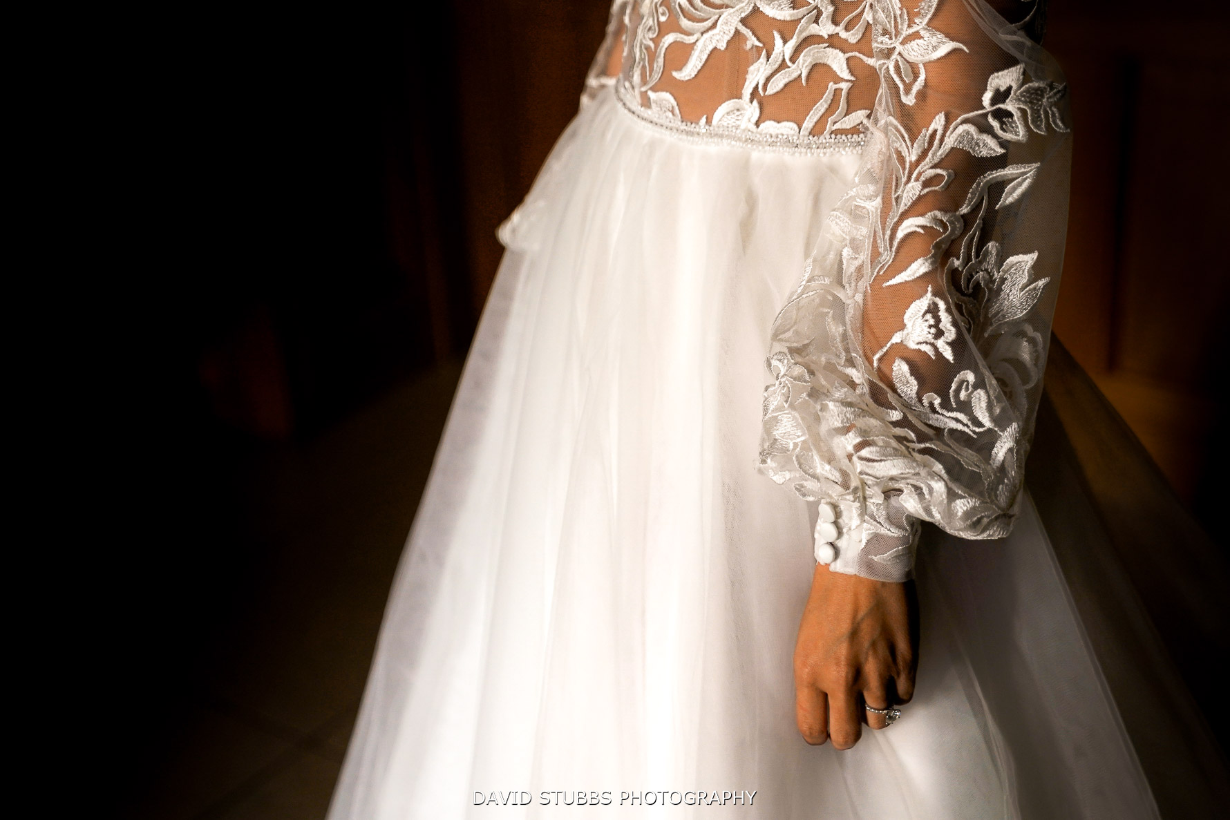 close up photo of the detail on the wedding dress