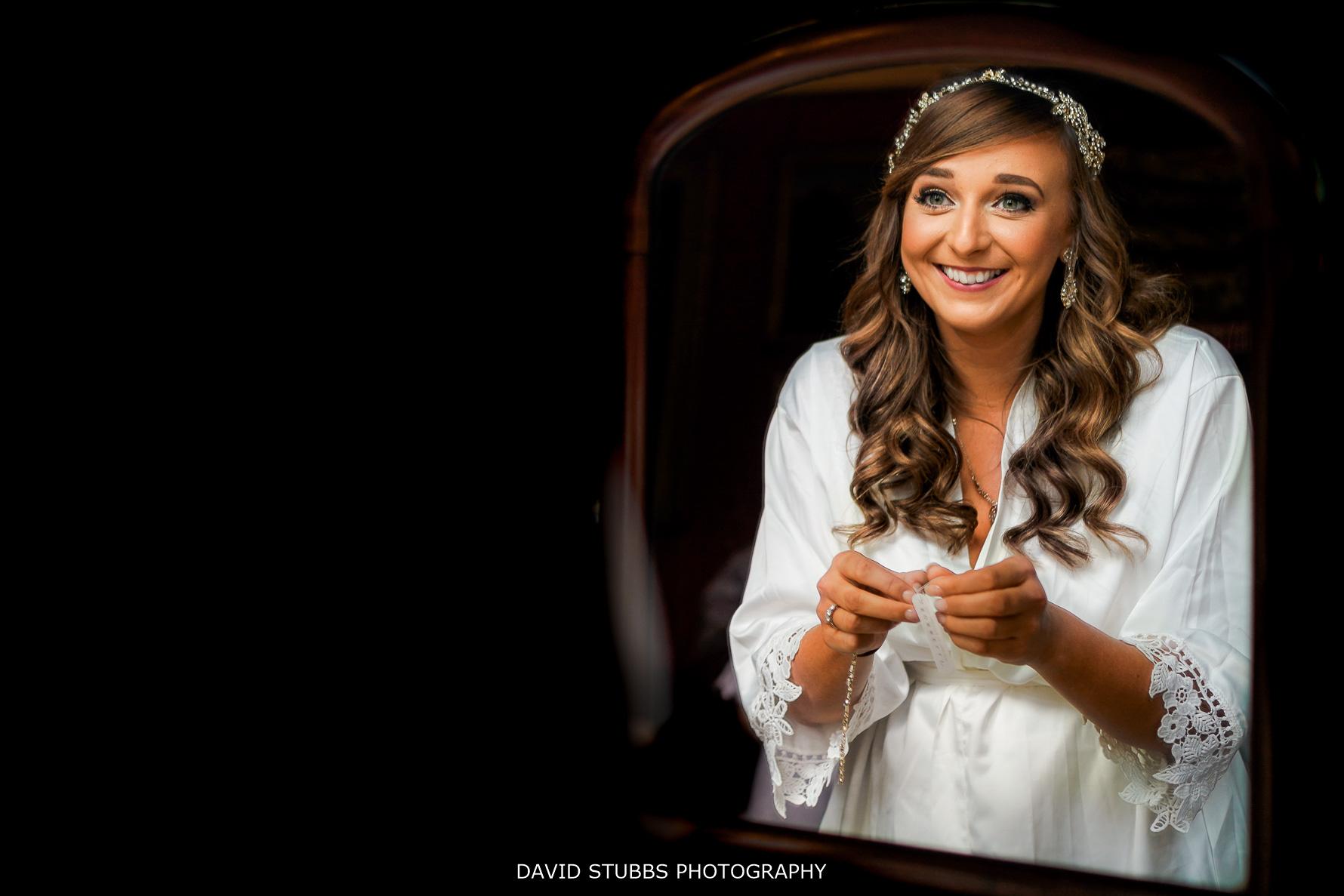 the bride reflection in big mirror