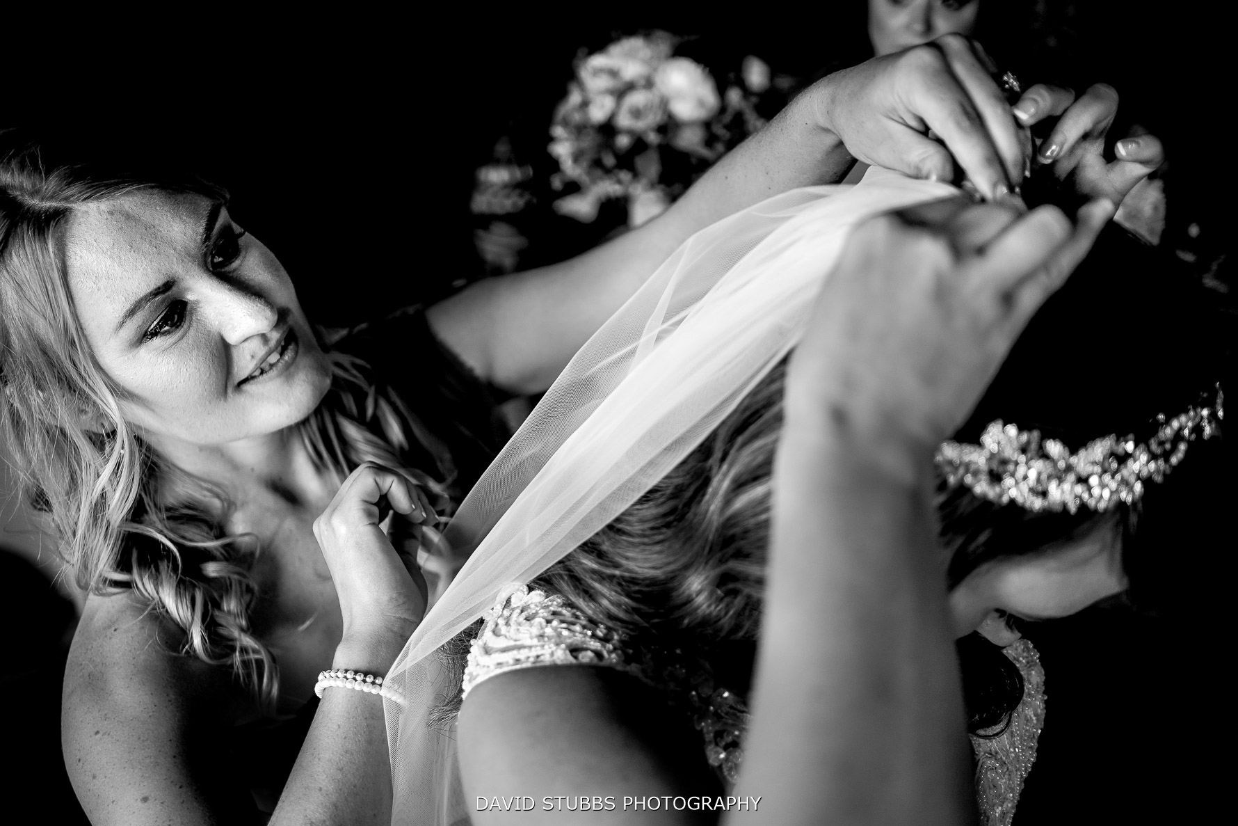 the veil being put into the bride