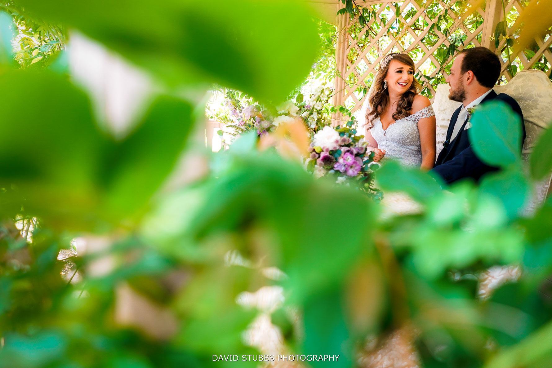 bride and gorom in love under canopy