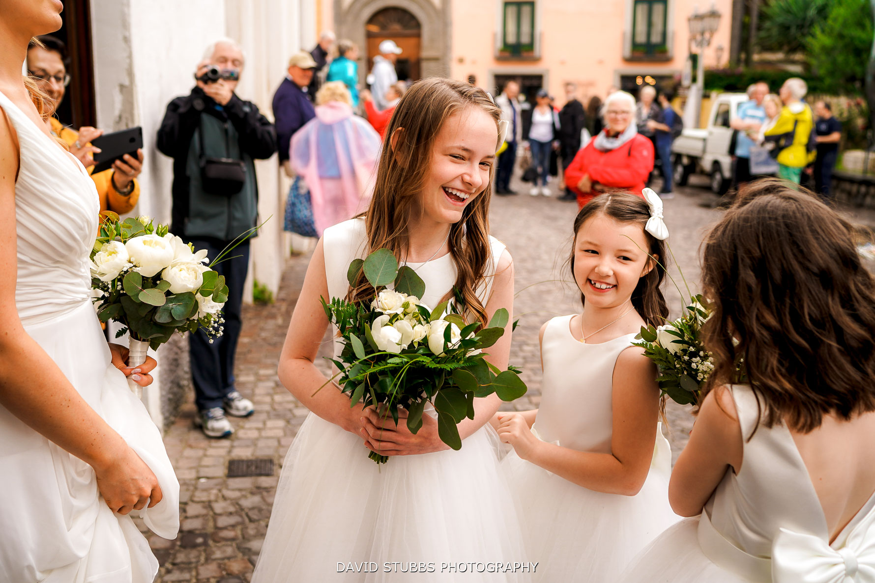 flower girls having a great time in the courtyard