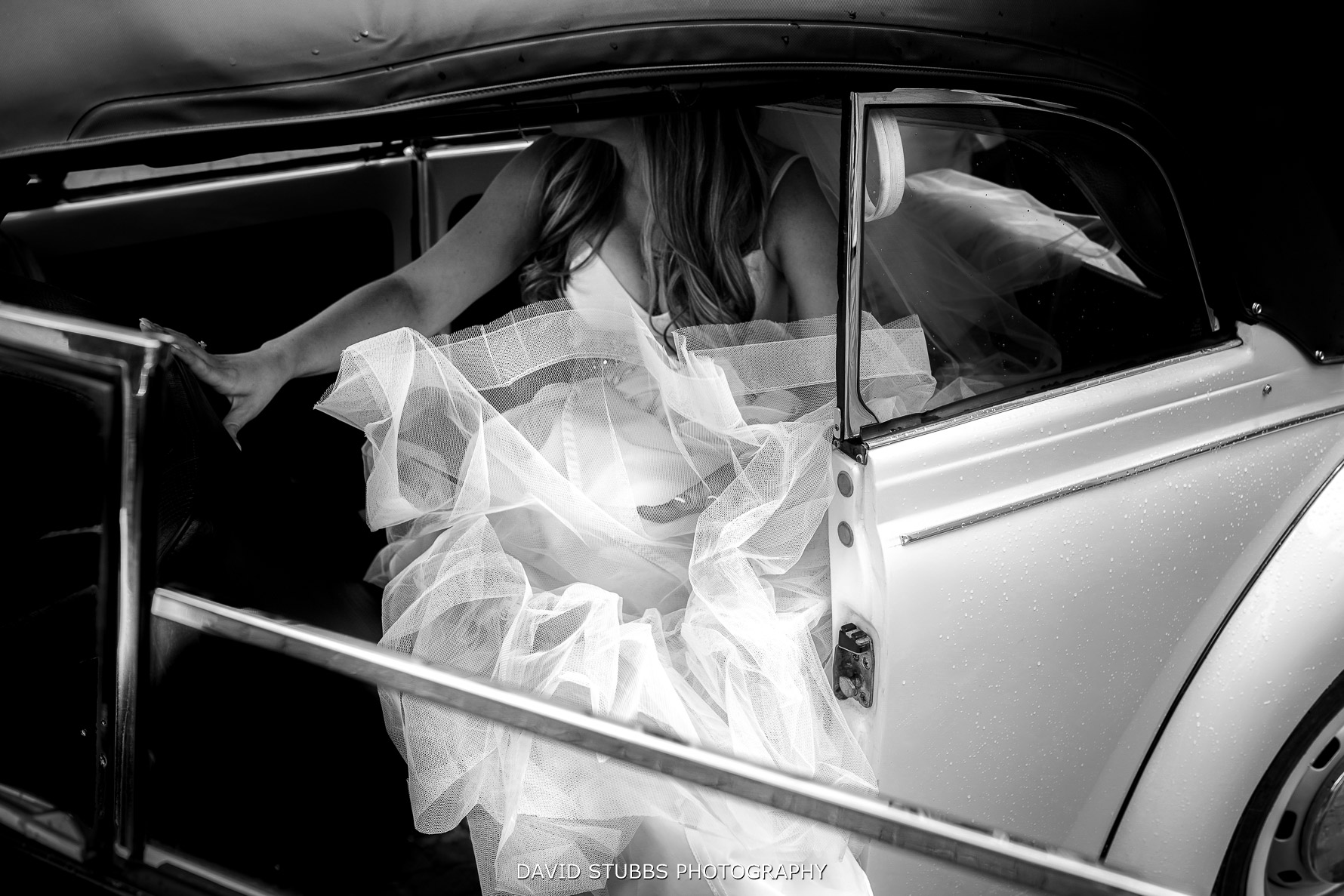 brides dress as she leaves the car